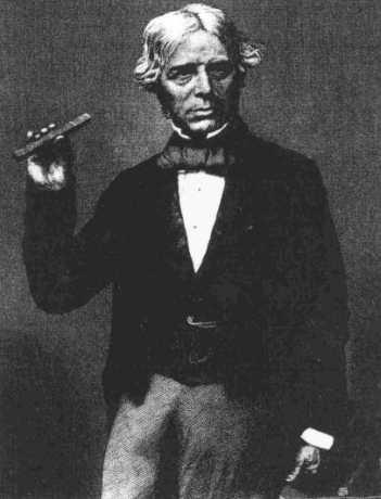 Faraday con uno de los tubos de cristal con los que hizo el experimento de la polarización de la luz. La imagen es de alrededor de 1857.